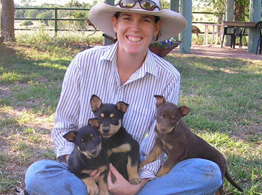Sarah with kelpie pups by Jed